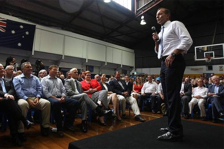 Tony Abbott speaks at the party rally at Auburn Basketball Centre while Liberal heavyweights including Joe Hockey and Malcom Turnbull look on. Photo: Dean Sewell