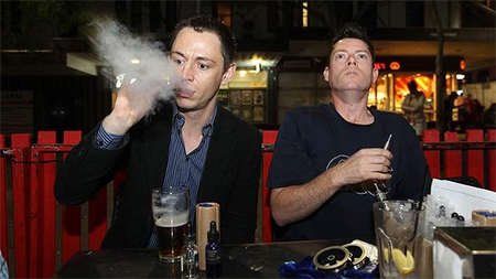 Recharging: Leon Alegria and Damian Duncan enjoy their electronic cigarettes at their local pub