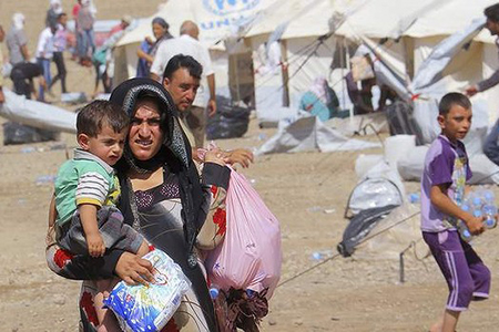 Syrian refugees who fled the violence in Syria at a refugee camp in Arbil, north of Baghdad