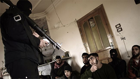 Syrian rebels in Maaret Ikhwan, near Idlib, listen attentively to a trainer showing them how to use a rocket launcher as the civil war escalates across the country